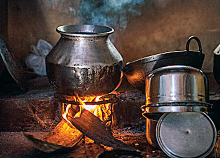 Indian metal pots are modelled on the earthen pots which cook on cow-dung or wood fires that surround the sides of the pots, making handles impractical