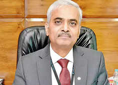 Amalgamation of BOB, Vijaya, Dena a complex process: Karnam Sekar of Dena Bank