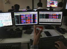 ETMarkets Morning Podcast: RBI says no to LVB-Indiabulls merger; US Fed turns more dovish & more