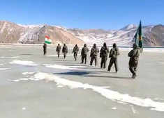 ITBP jawans march with national flag on frozen water body in Ladakh on Republic Day