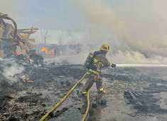 Fire visible across Los Angeles burns commercial yard, buses
