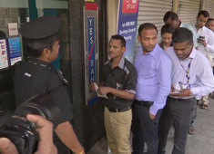 Customers rush to ATMs after RBI caps Yes Bank withdrawal limit