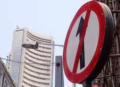 Sensex drops 300 pts on weak global cues, Nifty slips below 11,300; YES Bank surges 19%