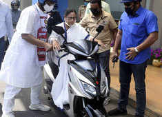 Watch: Mamata Banerjee nearly falls while driving electric scooter to protest fuel price hike
