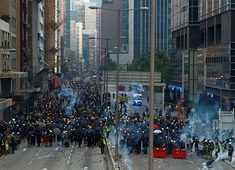 Violence erupts as pro-democracy protesters and riot police clash in Hong Kong