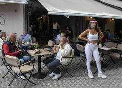 In race for tourism, Greece reopens cafes, island ferries