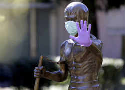 In fight against Coronavirus, statues around the world wear gloves and face masks