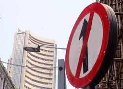 Sensex plunges over 350 pts amid weak global cues; Nifty trades below 17,500