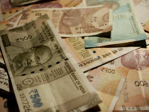 Rupee slips 3 paise to 71.11 against dollar in early trade