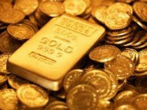 Gold slips on weak global cues, muted demand