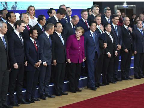 European, Asian leaders want free trade, push back at Donald Trump