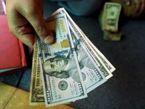 Rupee opens 5 paise up at 71.23 vs dollar