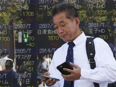 Nikkei dips as global growth concerns weigh; Panasonic tumbles