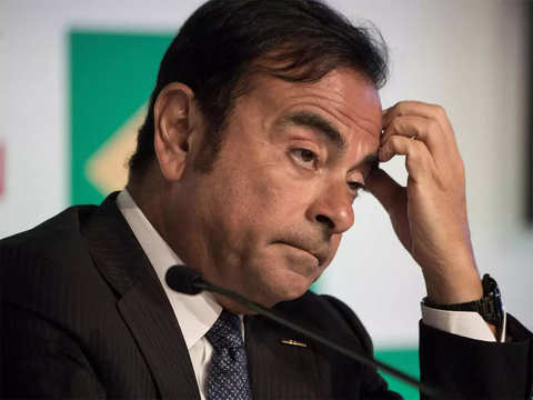 Former Renault boss Ghosn loses compensation, shares