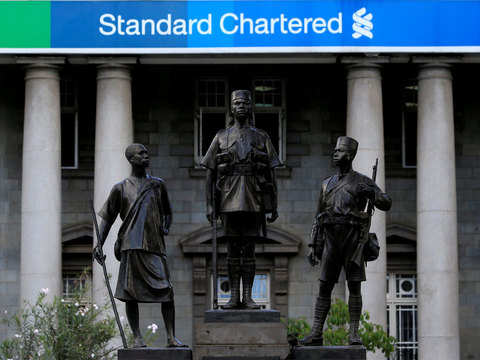 StanChart to take $900 million charge over US, UK probes