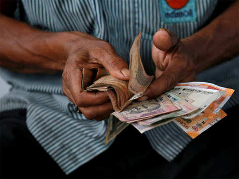 Rupee gains 20 paise against dollar, trades at highest level since Jan 7