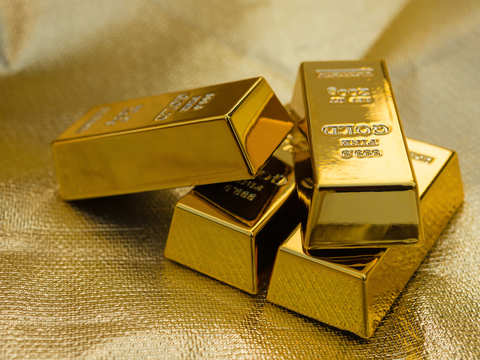 Gold hits near 2-week high on Brexit woes, weaker dollar