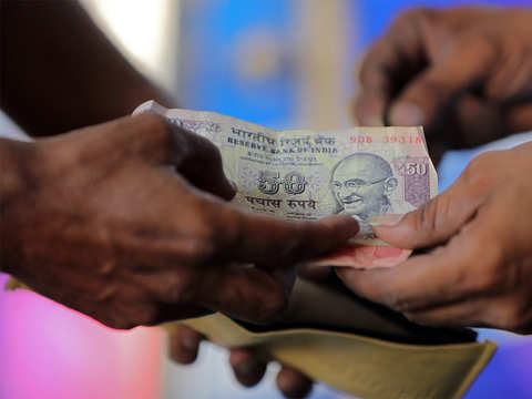 Rupee opens flat at 69.69 against dollar
