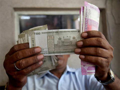 Rupee opens marginally higher against US dollar