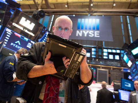 Wall Street flat as healthcare decline counters chip boost