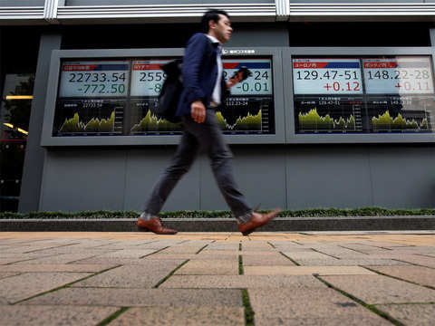 Nikkei retreats from 4.5-month high; Canon slumps on profit warning