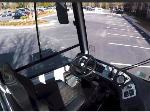 With driverless cars late, a startup tries remote-control trucks