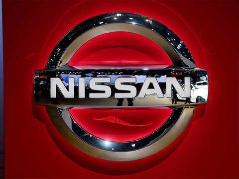 Nissan full-year net profit more than halves to near-decade low