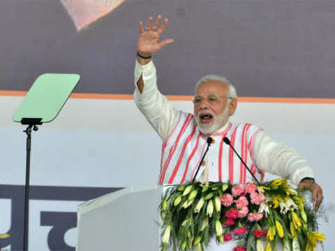 India's Modi set to return to power with a bigger majority, exit polls show