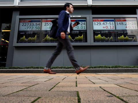 Nikkei closes flat amid US-China trade tension