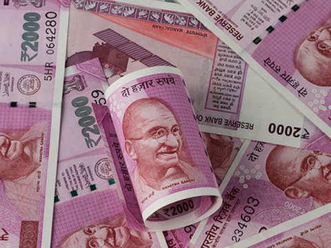 Rupee pares gains, settles 36 paise down at 70.02