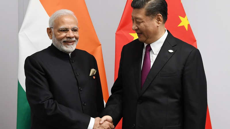 PM Narendra Modi meets Chinese President Xi Jinping , discusses ways