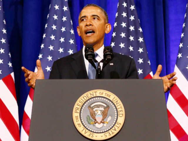 Obama signs $1 1 trillion spending bill, rider for Pakistan