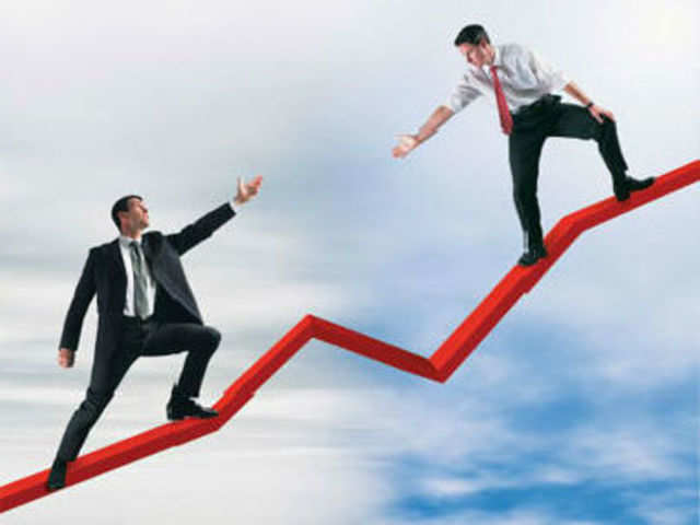 Want to move up at work? Believe in your company - The Economic Times