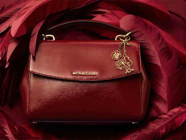 cbe3ea5483b0 Amidst slump, Michael Kors, Prada cut back on innovative bag designs