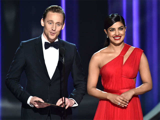 094390e55bd1 Style quotient at Emmys: Priyanka Chopra in deep red Jason Wu gown, Tom  Hiddleston in Gucci tuxedo. '