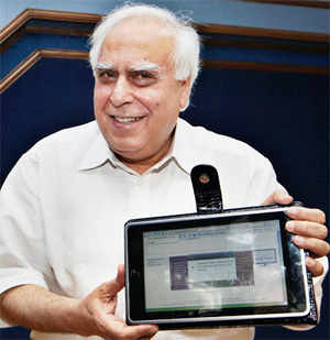 In this Thursday, July 22, 2010 photo, Human Resource Development Minister Kapil Sibal displayed the prototype of $35 basic touch screen tablet (AP)