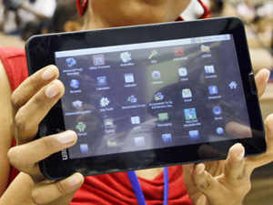 A student poses with the supercheap Aakash tablet computer which she received during its launch in New Delhi on Wednesday, Oct 5, 2011. The $35 basic touch screen tablet aimed at students can be used for functions like word processing, web browsing and video conferencing. (AP)