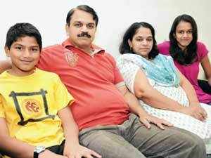 Avinash Kulkarni, with his wife Shalaka and children, at their home in Pune