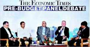 From Left: Daimler India CFO Sanjiv Khurana, Wheels India MD Srivats Ram, Former Hyundai Motors India President BVR Subbu and Ford India MD Michael Boneham at the ET Roundtable on What does India's Auto Sector Need For a Smoother Ride? The interaction was moderated by Abdul Majeed, National Automotive Leader-PricewaterhouseCoopers (extreme right).