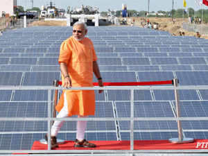 (In pics) Gujarat Chief Minister Narendra Modi walks in front of the solar panel during dedication and inaugration of India's first 1MW canal-top solar power plant at Chandrasan village in Mehsana district on April 24, 2012.