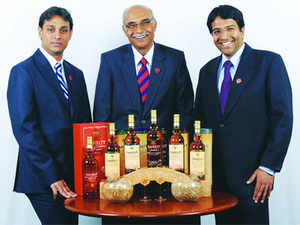 (L-R) TG Nikam, exec director;  Neelakanta Rao Jagdale, chairman & MD and Rakshit Jagdale, executive director