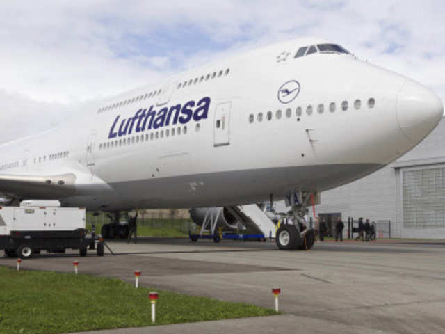 Visitor Walks Up To Second Floor On The New Boeing 747 8