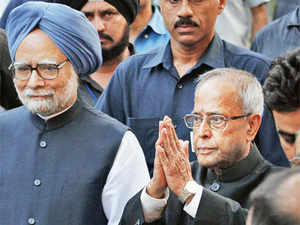 A Moment of Happiness: Prime Minister Manmohan Singh with Pranab Mukherjee outside the presidentelect's residence in New Delhi on Sunday (AP)