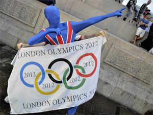 A performer poses with an Olympic flag at Trafalgar Square during the opening ceremony of the London 2012 Olympic Games. (AFP)