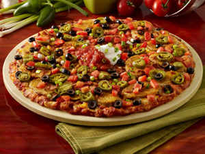 Yum! opened its first owned Pizza Hut store in India at Mumbai's Mira Road as it plans to take on Domino's Pizza more aggressively