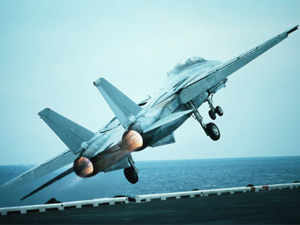 Military Aircraft Taking Off from Aircraft Carrier.