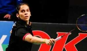 Saina Nehwal fought through a troubling knee to clinch her fourth title of the year by lifting the Denmark Open Super Series Premier trophy with a dominating win in the final on Sunday.