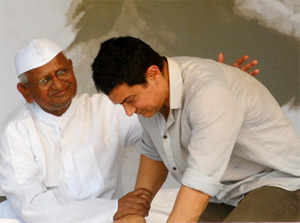 Veteran social activist Anna Hazare is likely to rope in Bollywood actor Aamir Khan for the new phase of his movement, which he plans to launch in January. (File photo)
