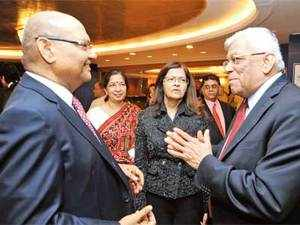 Anil Agarwal chats up Deepak Parekh as Shikha Sharma, Kalpana Morparia and Cyril Shroff look on.