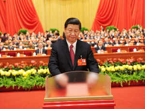 China's Vice President Xi Jinping casts his ballot during the closing session of the 18th National Congress of the Communist Party of China (CPC) at the Great Hall of the People in Beijing, in this November 14, 2012 photo released by China's official Xinhua News Agency.  The congress started its closing session on Wednesday morning, at which a new CPC Central Committee and a new Central Commission for Discipline Inspection will be elected. (Reuters photo)